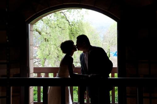 Linda & Jeff Enjoying an Intimate Moment On the Balcony